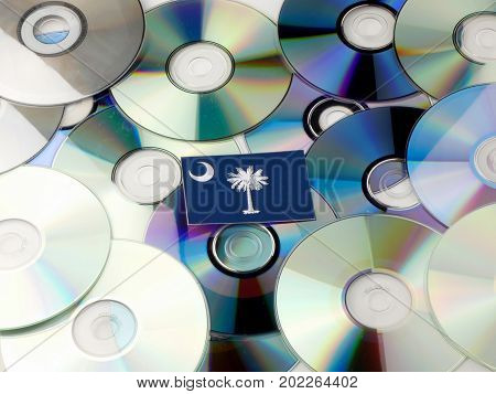 South Carolina Flag On Top Of Cd And Dvd Pile Isolated On White