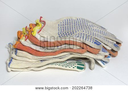 Pile Of Protective Cotton Anti-slip Gloves For Industrial Workers And Home Gardening