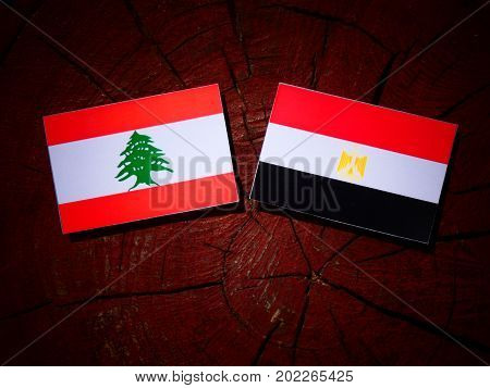 Lebanese Flag With Egyptian Flag On A Tree Stump Isolated