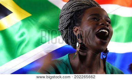 South African Young Black Woman Celebrating with South Africa Flag