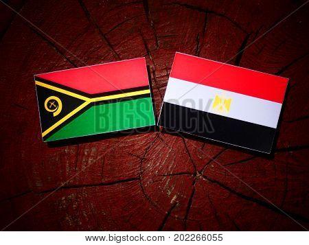 Vanuatu Flag With Egyptian Flag On A Tree Stump Isolated