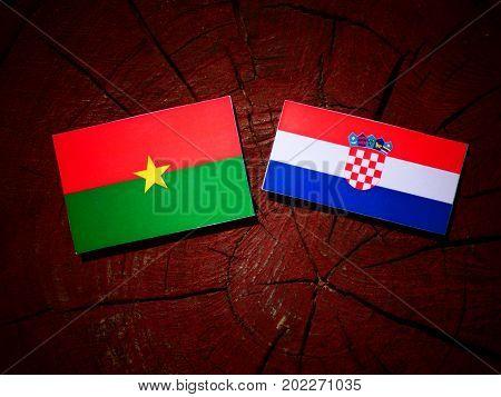 Burkina Faso Flag With Croatian Flag On A Tree Stump Isolated