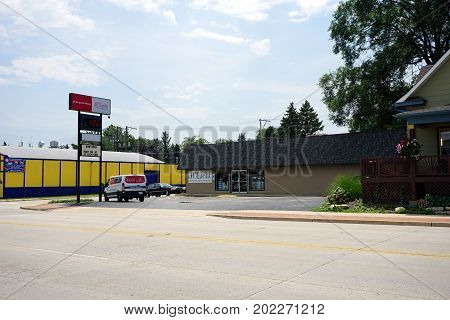 JOLIET, ILLINOIS / UNITED STATES - JULY 20, 2017: JC Licht offers Benjamin Moore paints and stains, window treatments, design consultations and supplies, on Plainfield Road in Joliet.