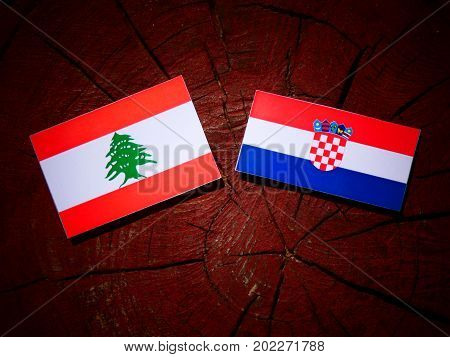 Lebanese Flag With Croatian Flag On A Tree Stump Isolated