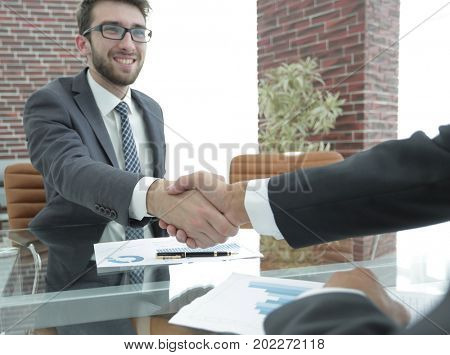 financial partners handshake after signing contract