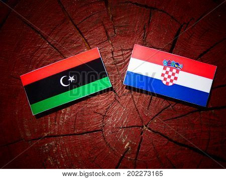 Libyan Flag With Croatian Flag On A Tree Stump Isolated