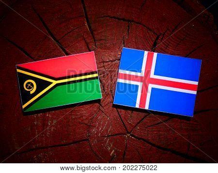 Vanuatu Flag With Icelandic Flag On A Tree Stump Isolated
