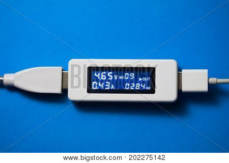 battery tester diagnostic tool, blue background