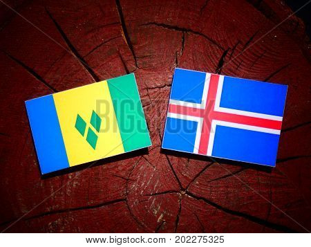 Saint Vincent And The Grenadines Flag With Icelandic Flag On A Tree Stump Isolated