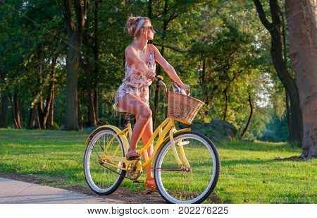 Happy Young Bicyclist Riding In City.