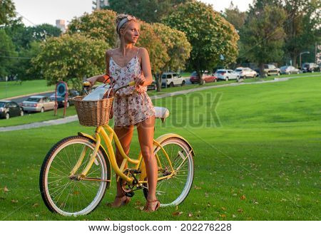Happy Young Bicyclist Riding In Park.