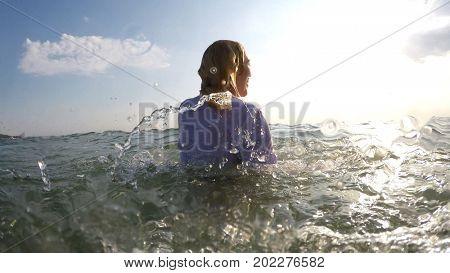 business woman have ? fun on a sea beach