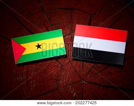 Sao Tome And Principe Flag With Yemeni Flag On A Tree Stump Isolated