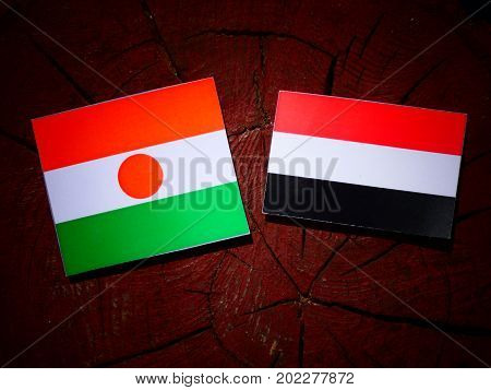 Niger Flag With Yemeni Flag On A Tree Stump Isolated
