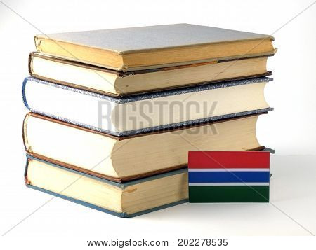 Gambia Flag With Pile Of Books Isolated On White Background