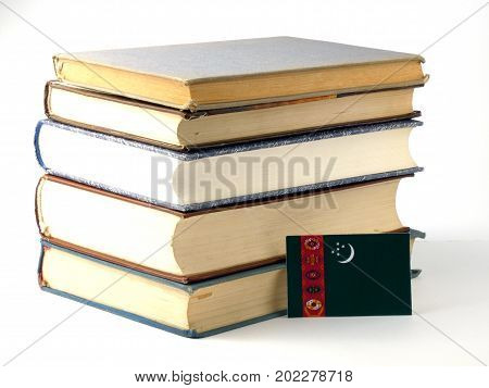 Turkmenistan Flag With Pile Of Books Isolated On White Background