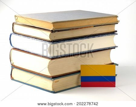 Colombian Flag With Pile Of Books Isolated On White Background