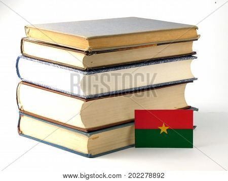 Burkina Faso Flag With Pile Of Books Isolated On White Background