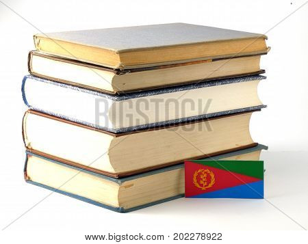 Eritrean Flag With Pile Of Books Isolated On White Background