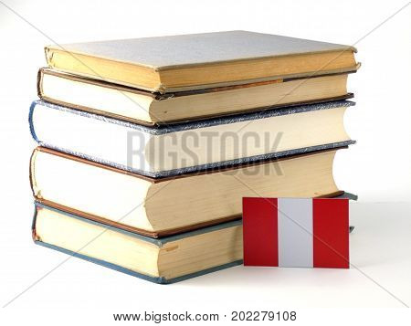 Peruvian Flag With Pile Of Books Isolated On White Background