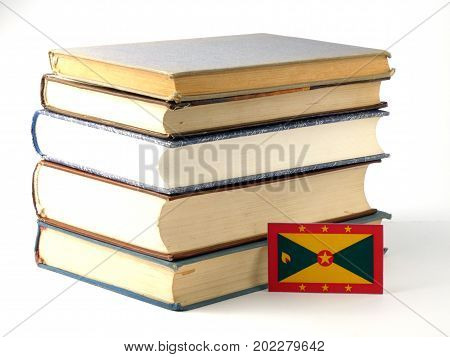 Grenada Flag With Pile Of Books Isolated On White Background