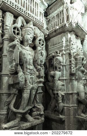 JAISALMER RAJASTHAN INDIA - MARCH 09 2016: Vertical picture of marble stone carving of Jain Gods in Jain Temples inside the fort of Jaisalmer in India.