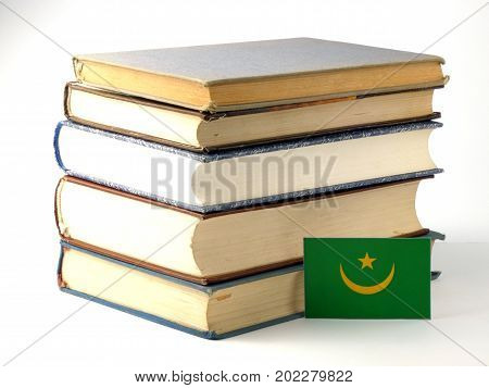 Mauritania Flag With Pile Of Books Isolated On White Background