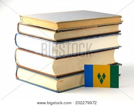Saint Vincent And The Grenadines Flag With Pile Of Books Isolated On White Background