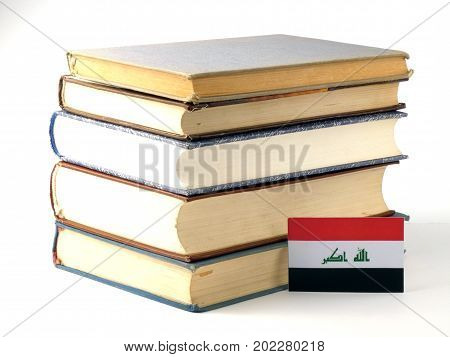 Iraqi Flag With Pile Of Books Isolated On White Background