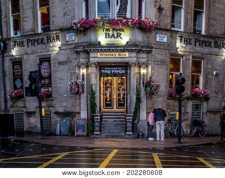 GLASGOW, SCOTLAND - JULY 20: The Piper Bar on July 20, 2017 in Glasgow, Scotland. The Piper Bar is a popular pub and whisky bar across the street from George Square.