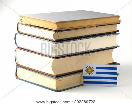 Uruguay Flag With Pile Of Books Isolated On White Background