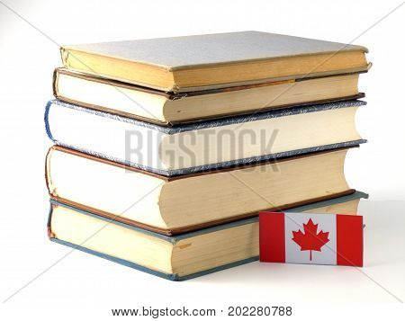 Canadian Flag With Pile Of Books Isolated On White Background