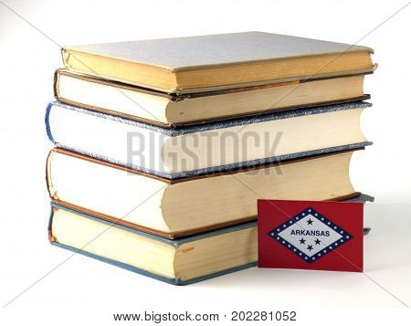 Arkansas Flag With Pile Of Books Isolated On White Background