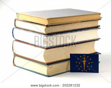 Indiana Flag With Pile Of Books Isolated On White Background