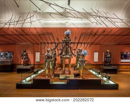 GLASGOW, SCOTLAND - JULY 21: Medieval armor in the Kelvingrove Art Gallery and Museum in Glasgow Scotland United Kingdom on July 21, 2017. The Kelvingrove is an main tourist attraction in Scotland.