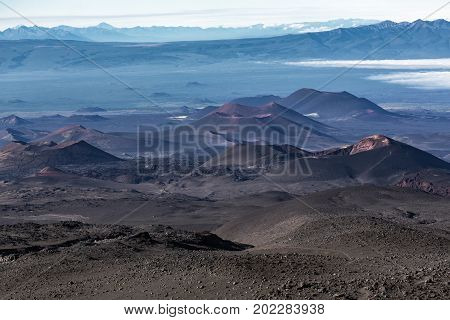 Beautiful volcano landscape of Kamchatka Peninsula: series of cinder cones and lava fields of fissure eruptions Plosky Tolbachik Volcano. Russian Far East Kamchatka Klyuchevskaya Group of Volcanoes.