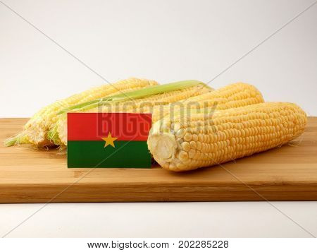 Burkina Faso Flag On A Wooden Panel With Corn Isolated On A White Background