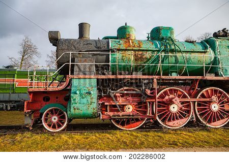 Old vintage steam locomotive from XX century Russian empire and USSR
