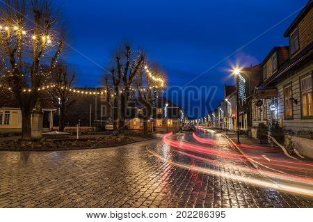 HAAPSALU, ESTONIA - OCTOBER 25, 2016: Small town square with pavement and tracers in the night. Heritage of the Nothern Europe.