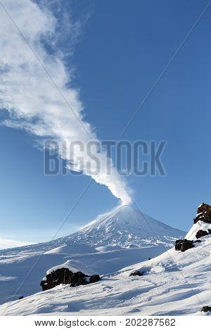 Volcano landscape of Kamchatka: eruption active Klyuchevskaya Sopka (Klyuchevskoy Volcano). Eurasia Russian Far East Kamchatka Peninsula Klyuchevskaya Group of Volcanoes.
