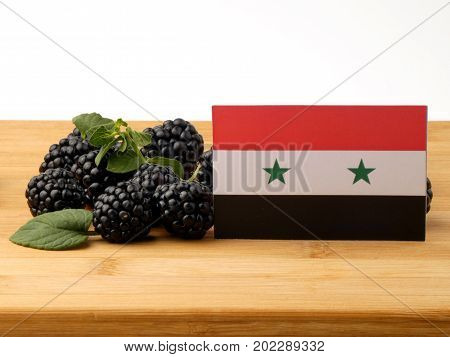 Syria Flag On A Wooden Panel With Blackberries Isolated On A White Background