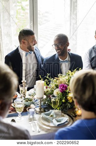 Cheerful Gay Couple in Wedding Reception