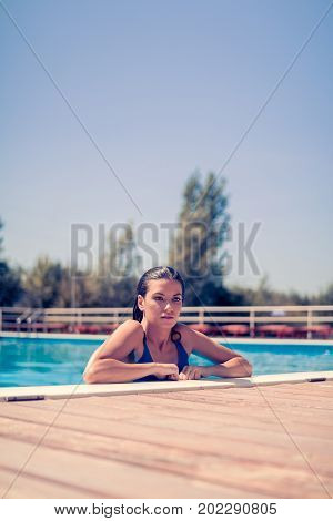 One Young Adult Woman, Serious Expression, Head And Shoulder Shot, Caucasian Model, In Swimming Pool
