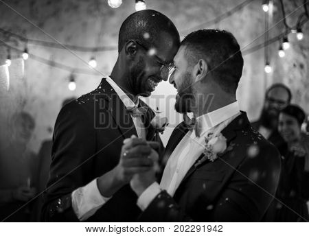 Newlywed Gay Couple Dancing on Wedding Celebration