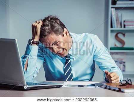 Businessman with desperate of facial expression suffering stress and headache. Photo of young man working in the office. Business concept