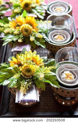 Flower with incense lotus and candles for praying buddha on the golden tray