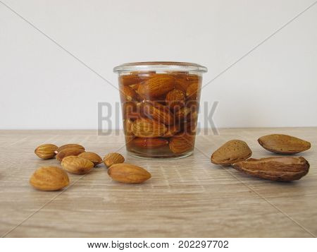 With water soaked and activated almonds in jar