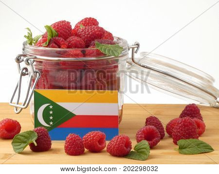 Comoros Flag On A Wooden Panel With Raspberries Isolated On A White Background