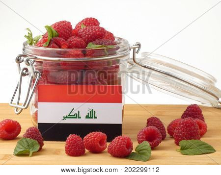Iraqi Flag On A Wooden Panel With Raspberries Isolated On A White Background