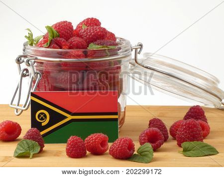Vanuatu Flag On A Wooden Panel With Raspberries Isolated On A White Background